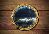 ship porthole with storm outside