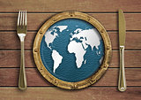 Fork, knife and porthole with world map inside