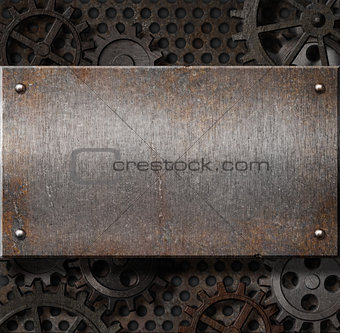 metal plate over rusty gears background