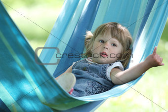 little girl on a hammock,