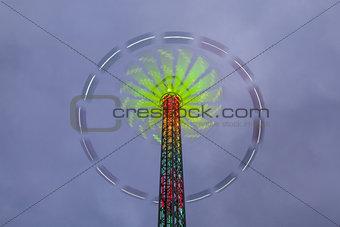 Danger carousel - big wheel in motion at night