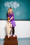 Young girl with umbrella indoors