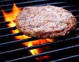 Burger Cooking On The Grill