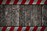 wooden background with warning bars
