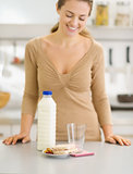 Closeup on breakfast of young woman in kitchen