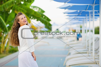 Portrait of smiling young woman on vacation