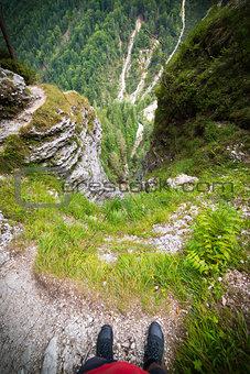 A man over deep void in Julian Alps in Slovenia