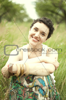 cute girl resting on fresh spring grass