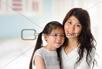 Young girl and mother at home.