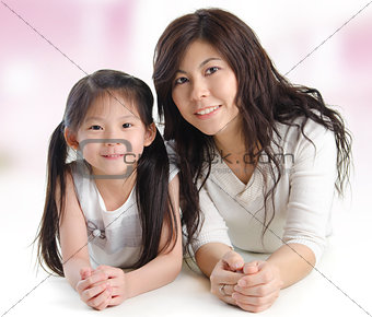 Portrait of a joyful mother and her daughter