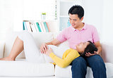 Asian pregnant couple having conversation