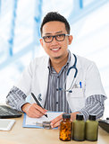 Asian medical doctor working on his desk