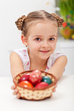 Girl with basket full of easter eggs