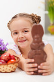 Happy easter girl with chocolate bunny
