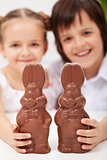 Happy easter kids with large chocolate bunnies