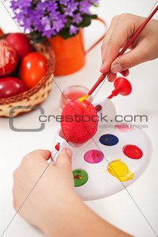 Painting the easter eggs