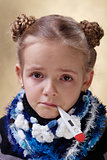 Little girl with red eyes having the flu