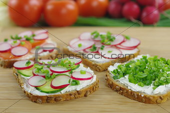 four slices of bread with cottage cheese and the vegetables