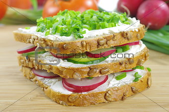 three slices of bread with cottage cheese and the vegetables