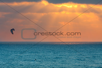 Kitesurfer on Mediterranean sea at sunset in Israel.