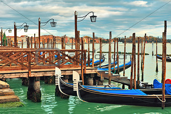Gondolas moored in row on Grand canal in Venice.