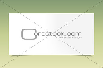 Blank white paper on green background