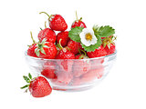 Strawberries with leaves and flower on plate