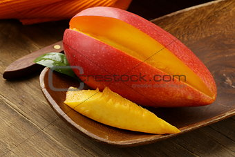 fresh fruit mango on wooden plate