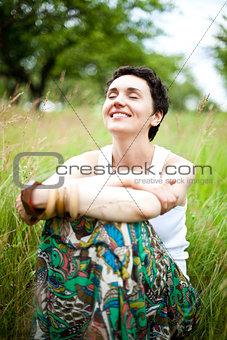 cute girl resting on fresh spring grass