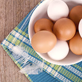 eggs in a bowl, towel and feathers