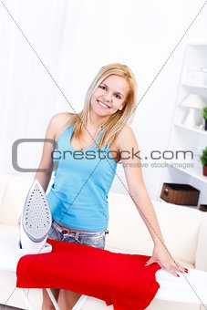 Pretty housewife ironing