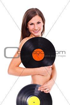 Sexy nude girl holding vinyl discs