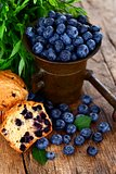 Blueberries in antique mortar