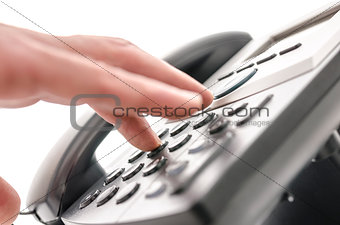 Detail of a hand using a phone keypad