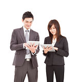 businessman and businesswoman using tablet pc