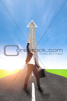 success businessman with the road rising up background