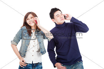 happy Young couple talking on smart phone