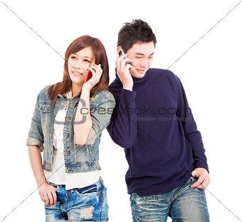 happy asian couple talking on the phone