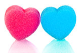Two hearts of blue and pink lips on a white background