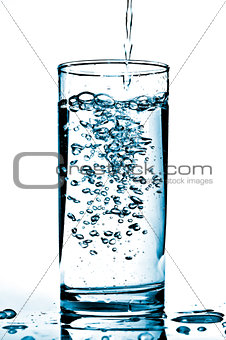 Cold water being poured into a glass.