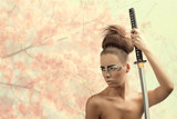 brunette in japan style with katana looks at right