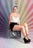 Pinup Housewife Sitting On Vintage Television Set