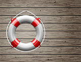Life Buoy on  a Wooden Paneled Wall with Copy Space.