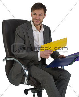 businessman at office sits in a chair