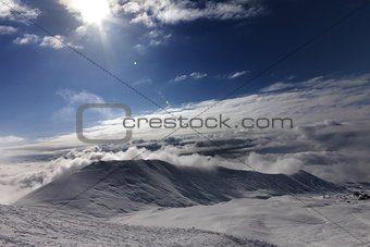 Off-piste slope in clouds