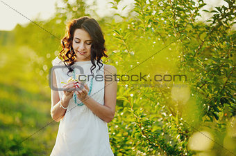 beautiful summer girl with chamomile  in hands