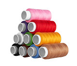 many-coloured bobbins of thread