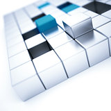 Abstract silver and blue metallic cubes on a white