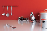 metallic kitchenware on a background of red wall