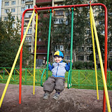 Boy Playing on Playground